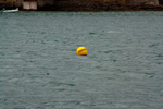 Harbour bouy with the words Fairway on it